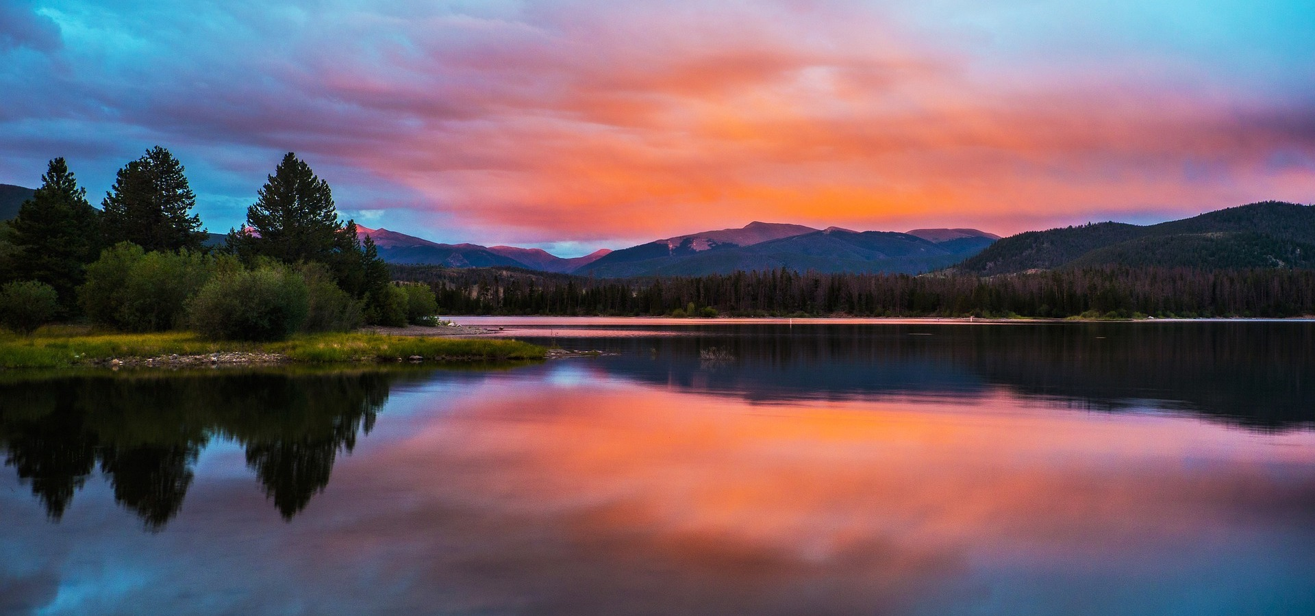 Sunset reflected in mountain lake