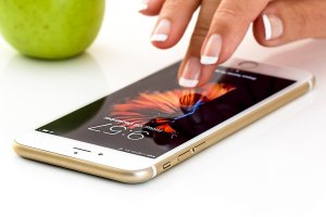 Woman's fingers touching an iphone